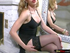 Blonde TS in sexy stockings surprises with pretty long cock