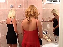 Shemale and blonde girl fuck in bathroom