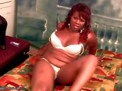 BBW ebony tranny strips bra and panties and jizzes her cock