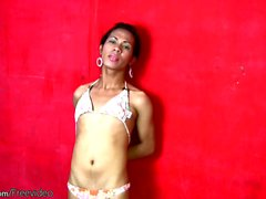 Tall Filipino tgirl takes off colorful lingerie and strokes