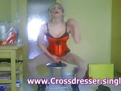 CD slut in red Corset is riding on Monster Dildo