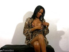 Busty tgirl strips off lingerie and strokes her black mamba