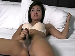 Thai beauty with cock fucks her tight ass with fat cucumber
