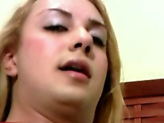Light haired tranny plays with massive ass in tight thongs
