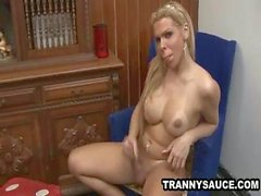 Busty blonde shemale gets naked and masturbates