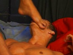 Young Latino twink kissing shemale feet