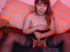 Cutie asian tgirl plays with toys and cums hard