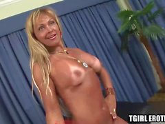 Busty transsexual blonde Tania enjoys in hard cock on a sofa