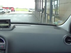 crossdresser sissy by car on the road in the parking lo