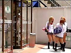 Asian Tgirl in uniform drills her classmate
