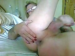 Tattooed mature shemale strokes her dick