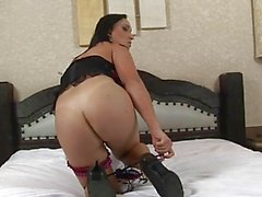 Chubby dark haired shemale in lingerie strips in bedroom